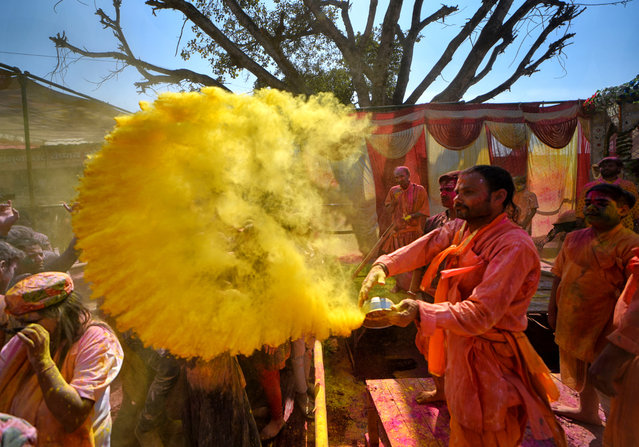 Hindu devotees are seen playing with Colourful powders and water during the Holi Festival celebration at Gokul dham, Mathura, Uttar Pradesh, India on March 18, 2019. (Photo by Avishek Das/SOPA Images/LightRocket via Getty Images)