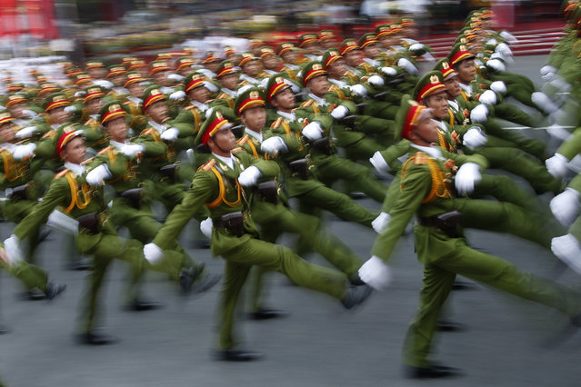 """Military personnel take part in a parade celebrating the 40th anniversary of the end of the Vietnam War which is also remembered as the """"Fall of Saigon"""", in Ho Chi Minh City, Vietnam, Thursday, April 30, 2015. The city once known as Saigon was festooned in red banners on Thursday that read """"Long Live the Glorious Party of Vietnam"""". (Photo by Dita Alangkara/AP Photo)"""