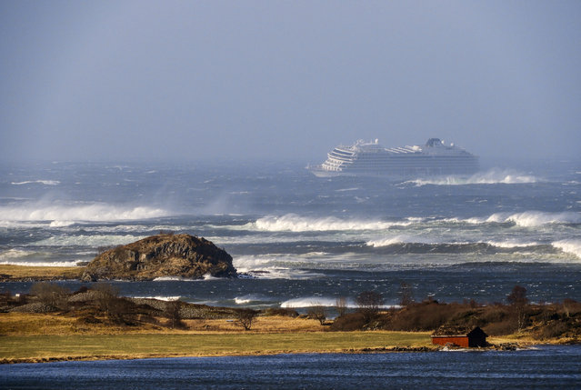 The cruise ship Viking Sky as it drifts after sending a Mayday signal because of engine failure in windy conditions near Hustadvika, off the west coast of Norway, Saturday March 23, 2019.  The Viking Sky is forced to evacuate its estimated 1,300 passengers. (Photo by Odd Roar Lange/NTB Scanpix via AP Photo)
