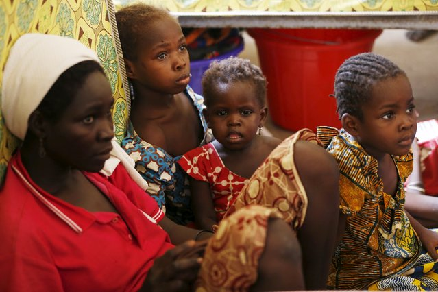 A mother and her children rescued from Boko Haram in Sambisa forest rest in the domitory at the Malkohi camp for Internally Displaced People in Yola, Adamawa State, Nigeria, May 3, 2015. (Photo by Afolabi Sotunde/Reuters)