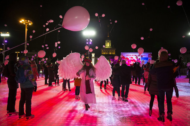 Young people release red balloons during a flash mob to mark Valentine's Day in Moscow, Russia, Tuesday, February 14, 2017. (Photo by Alexander Zemlianichenko/AP Photo)