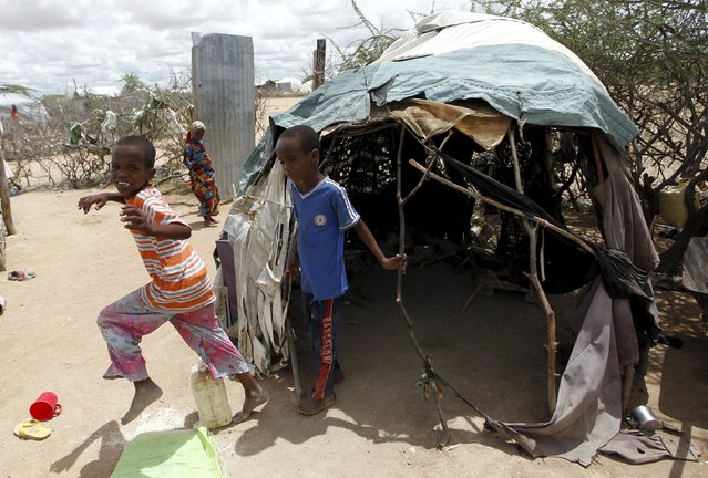 Somali refugees run from their makeshift shelter at the Ifo camp in Dadaab near the Kenya-Somalia border, May 8, 2015. (Photo by Thomas Mukoya/Reuters)