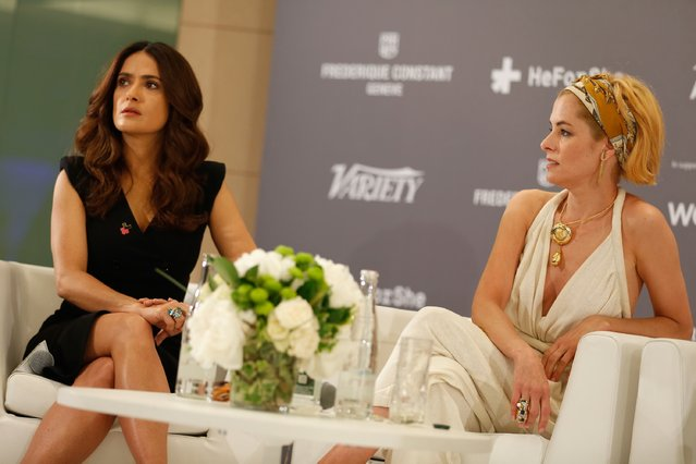 Actors Salma Hayek (L) and Parkery Posey onstage during the Variety and UN Women's panel discussion on gender equality at 68th Cannes Film Festival at Radisson Blu on May 16, 2015 in Cannes, France. (Photo by Tristan Fewings/Getty Images for Variety)