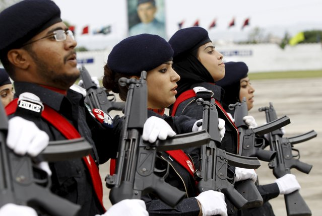 Police academy graduates march during their graduation ceremony in Islamabad, Pakistan May 18, 2015. (Photo by Caren Firouz/Reuters)