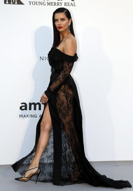 Adriana Lima poses for photographers upon arrival at the amfAR, Cinema Against AIDS, benefit at the Hotel du Cap-Eden-Roc, during the 72nd international Cannes film festival, in Cap d'Antibes, southern France, Thursday, May 23, 2019. (Photo by Eric Gaillard/Reuters)