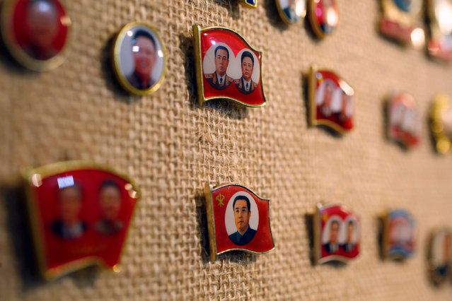 Pins featuring former North Korean leader Kim Il Sung and Kim Jong Il are displayed in a glass case of Thomas Hui at his apartment in Hong Kong, China April 11, 2016. (Photo by Bobby Yip/Reuters)