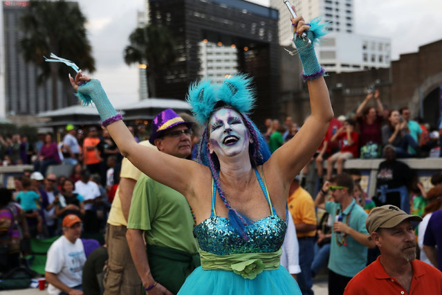 Andrea McGuffee dances during Lundi Gras celebration during Mardi Gras in New Orleans, Louisiana U.S., February 27, 2017. (Photo by Shannon Stapleton/Reuters)
