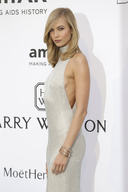 Model Karlie Kloss poses for photographers upon arrival for the amfAR Cinema Against AIDS benefit at the Hotel du Cap-Eden-Roc, during the 68th Cannes international film festival, Cap d'Antibes, southern France, Thursday, May 21, 2015. (Photo by Thibault Camus/AP Photo)