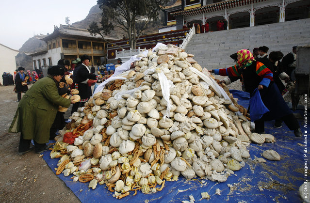 Villagers donate their bread to lamas