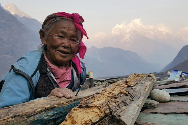 A Nepalese woman poses for a picture in the Khumbu Valley in the Everest region of Nepal in this picture taken April 11, 2016. (Photo by Antoni Slodkowski/Reuters)