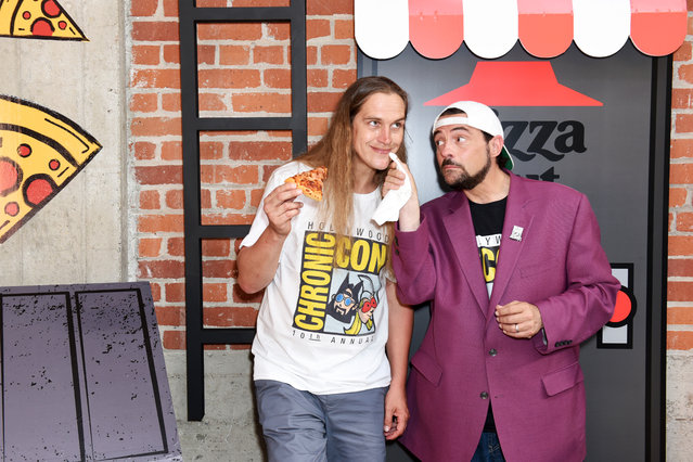 """(L-R) Jason Mewes and Kevin Smith of """"Jay and Silent Bob"""" attend the Pizza Hut Lounge at 2019 Comic-Con International: San Diego on July 18, 2019 in San Diego, California. (Photo by Presley Ann/Getty Images for Pizza Hut)"""
