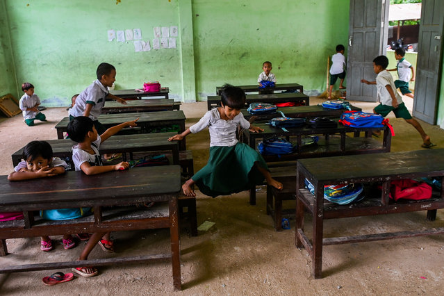 In this picture taken on June 18, 2019 students play in their classroom of a government school on the outskirts of Yangon, Myanmar. (Photo by Ye Aung Thu/AFP Photo)