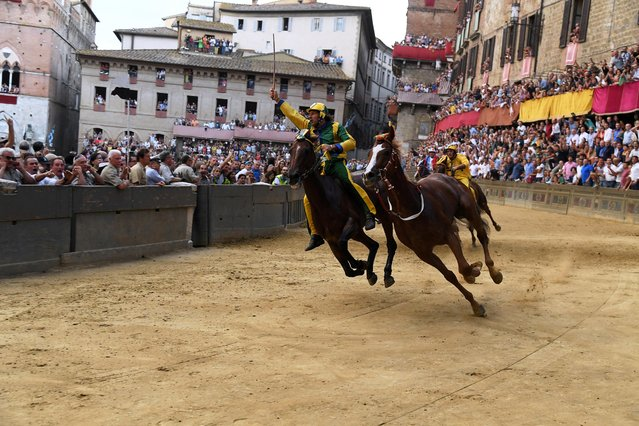 "Horse Remorex, of the ""Selva"" (Forest) parish, is seen without his jockey as he wins the historical Palio of Siena horse race, in Siena, Italy on August 16, 2019. (Photo by Alberto Lingria/Reuters)"