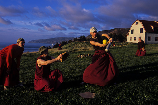 Monks at Nova Scotia's Gampo Abbey practive softball, Canada, 2005. (Photo by Steve McCurry)