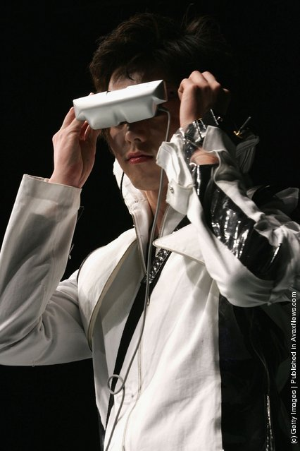 South Korean models, with wearable computers, walk the cat walk during the Ubiquitous Fashionable Computer Fashion Show