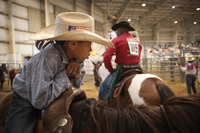 Lindon Demery waits for the start of competition and his turn in the junior barrel racing event at the Bill Pickett Invitational Rodeo on April 1, 2017 in Memphis, Tennessee. (Photo by Scott Olson/Getty Images)
