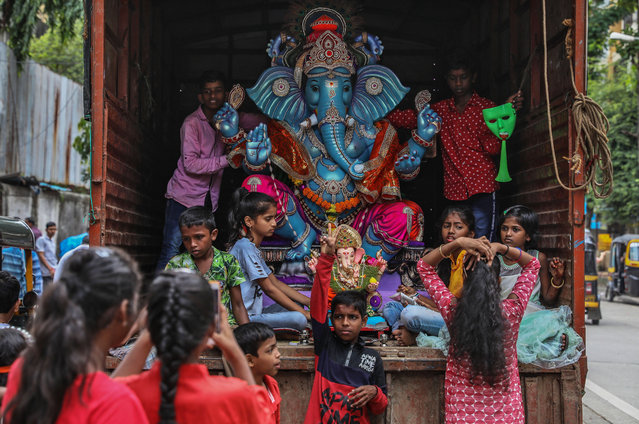 Indian devotee prepare to transport an idol of the elephant-headed Hindu God Ganesha in a truck from a workshop during Ganesh Chaturthi, or Ganesha Festival, in Mumbai, India, 02 September 2019. Ganesha Chaturthi is a day on which Lord Ganesha is believed to bestow his presence on earth for all his devotees. It is celebrated as the birthday of Lord Ganesha. The festival is observed in the Hindu calendar month of Bhaadrapada, starting on the Shukla Chaturthi, the fourth day of the waxing moon period. Ganesha Chaturthi, a ten-day long event which is celebrated all over India. (Photo by Divyakant Solanki/EPA/EFE)
