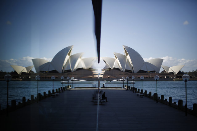 Sydney Opera House: The building is reflected in a harbourside hotel window in The Rocks district of Sydney, May 7, 2014. Since it's completion in 1973, the iconic Australian landmark has attracted millions of visitors and in 2007 became a UNESCO World Heritage site. (Photo by Jason Reed/Reuters)