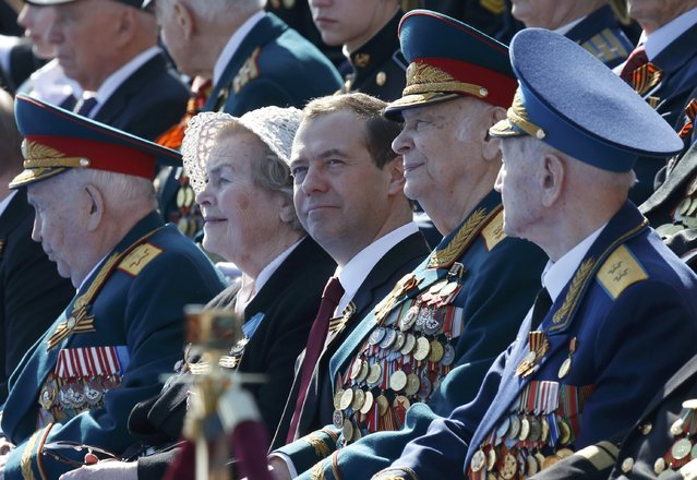Russian Prime Minister Dmitry Medvedev (C) and World War Two veterans attend the Victory Day parade, marking the 71st anniversary of the victory over Nazi Germany in World War Two, at Red Square in Moscow, Russia, May 9, 2016. (Photo by Grigory Dukor/Reuters)