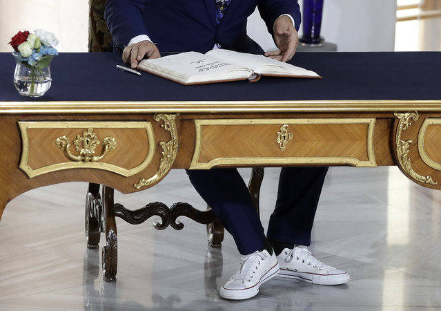 Albanian Prime Minister Edi Rama, wearing sport shoes, signs into a book upon his arrival for the V4+West Balkan summit in Prague, Czech Republic, Thursday, September 12, 2019. (Photo by Petr David Josek/AP Photo)