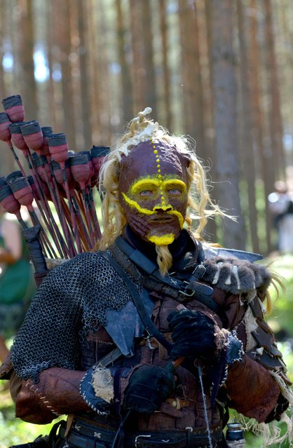 A fan dressed as orc is seen in the forest near the village of Doksy, some 80 km from Prague on June 6, 2015. (Photo by Michal Cizek/AFP Photo)