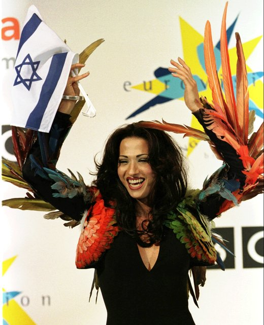 "In this Sunday May 10, 1998 file photo, Israeli singer Dana International celebrates her victory in the Eurovision Song Contest at the Birmingham Indoor Arena, England. The Israeli was the first transgender person to win the annual competition. Though there was uproar in some sections of Israeli society, Dana's performance of ""Diva"" captured the hearts of voters across Europe. (Photo by Louisa Buller/AP Photo)"