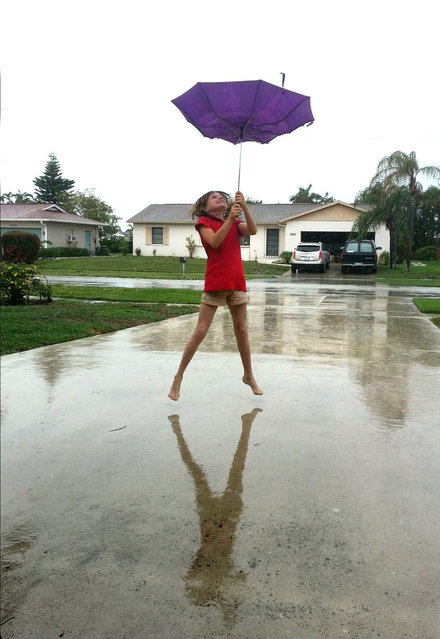 "Point & Shoot Challenge: ""April Showers"" photo by Nancy Nash of Marco Island. It was a rainy day and her daughter, Elizabeth, was playing in the driveway. (Photo by Nancy Nash)"