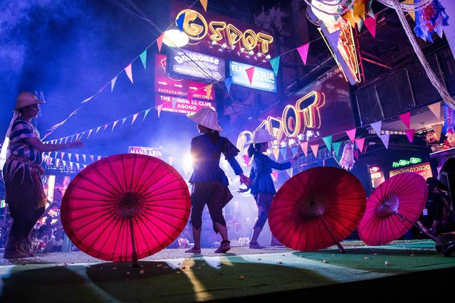 This photo taken on March 29, 2017 shows performers dancing on a stage set up in a red light district of Pattaya at an event used to highlight a push by the city to promote safety in the area. (Photo by Roberto Schmidt/AFP Photo)