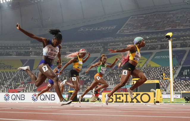Shelly-Ann Fraser-Pryce (6), of Jamaica, finishes ahead of Dina Asher-Smith (7), of Great Britain, and Marie-Josée Ta Lou (4), of The Ivory Coast, in the women's 100-meter final at the World Athletics Championships in Doha, Qatar, Sunday, September 29, 2019. (Photo by David J. Phillip/AP Photo)
