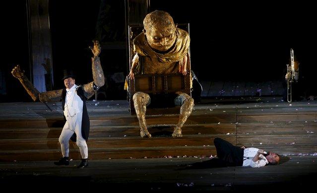 "Actors Cornelius Obonya as Jedermann and Juergen Tarrach (L) as Mammon perform on stage during a dress rehearsal of Hugo von Hofmannsthal's drama ""Jedermann"" (Everyman) at Domplatz square in Salzburg, Austria, July 16, 2015. (Photo by Leonhard Foeger/Reuters)"