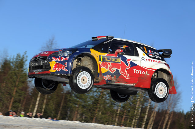 Sebastien Loeb of France and Daniel Elena of Monaco compete in their Citroen Total WRT Citroen DS3 WRC during Day 3 of the WRC Rally Sweden