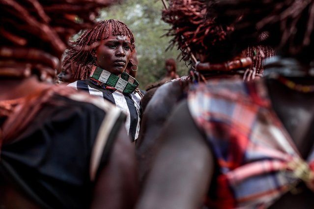 "Female members of the Hammer tribe from the village of Turmi, situated in southern Ethiopia near the Kenyan border, dance as part of a ritual called the ""bull jumping ceremony"" that takes place during the passage of a young boy to adulthood, in Turmi, Ethiopia, 25 September 2019. (Photo by Stéphanie Lecocq/EPA/EFE)"