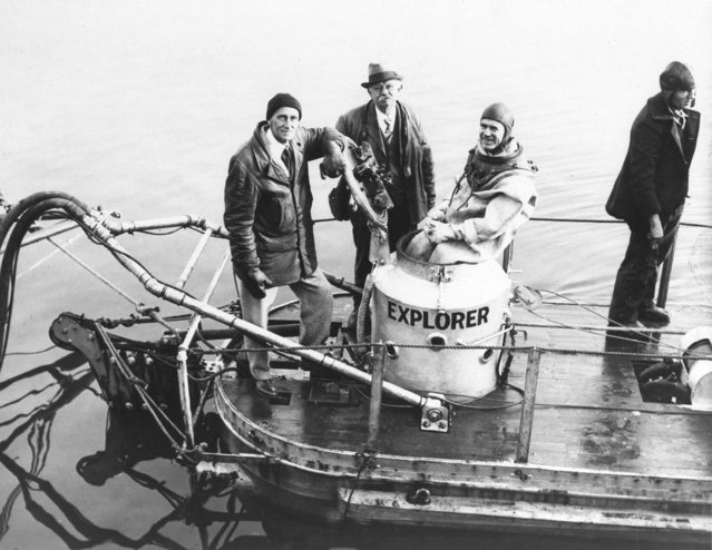 Dr. William Beebe, noted naturalist, Simon Lake, vet submarine inventor, and Frank Crilley, deep sea diver, left to right, pictured aboard the aboard the Explorer, a midget undersea craft during a demonstration held off City Island, New York, December 20, 1932. The Explorer which is a compromise between a diving bell and a submarine is only 22 feet long with a 6-foot beam. (Photo by AP Photo)