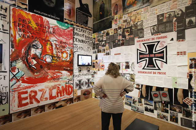 A visitor looks at an installation by artist Jonathan Meese at the exhibition ARTandPRESS at Martin Gropius Bau