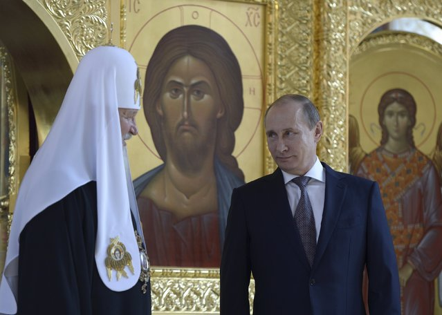 Russian President Vladimir Putin (R) listens to Patriarch of Moscow and All Russia Kirill at the recently renovated St. Prince Vladimir Cathedral during a celebration of 1000 year anniversary of the Great Prince Vladimir canonization in Moscow, Russia, July 27, 2015. (Photo by Alexei Nikolsky/Reuters/RIA Novosti/Kremlin)
