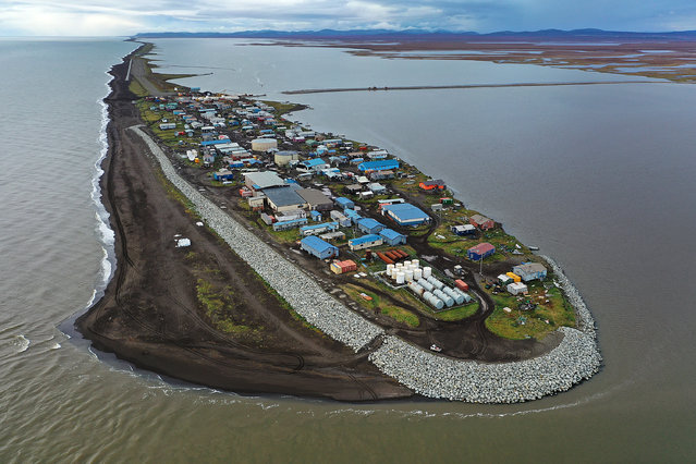 An aerial view from a drone shows Kivalina, which sits at the very end of an eight-mile barrier reef located between a lagoon and the Chukchi Sea on September 10, 2019 in Kivalina, Alaska. The village is 83 miles above the Arctic circle. Kivalina and a few other native coastal Alaskan villages face the warming of the Arctic, which has resulted in the loss of sea ice that buffers the island's shorelines from storm surges and coastal erosion. The residents of Kivalina are hoping to stay on their ancestral lands where they can preserve their culture, rather than dispersing due to their island being swallowed by the rising waters of the ocean. City Administrator Colleen Swan says that the way of life in the village will change with the changing climate and they will adapt. In days gone by, they could migrate with the changes. But now, she says, with the magnitude of problem climate change brings, they must hope that the rest of the world reverses the trend, which she sees as being man-made, and save their way of life. (Photo by Joe Raedle/Getty Images)