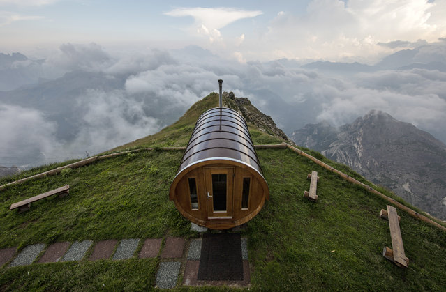A sauna building sits above the clouds at 9,280 feet (2,752 meters) at the Rifugio Lagazuoi in the Dolomite Mountains near Cortina d' Ampezzo in northern Italy July 17, 2015. The Dolomites are home to the Dolomiti Bellunesi National Park and were declared a UNESCO World Heritage Site in August, 2009. (Photo by Bob Strong/Reuters)