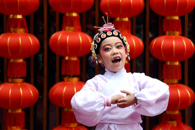 A child performs opera during celebrations on the eight day of Chinese Lunar New Year of the Pig, in Taizhou, Zhejiang province, China February 12, 2019. (Photo by Reuters/China Stringer Network)