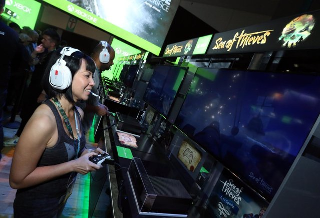 """An E3 2016 attendee plays """"Sea of Thieves"""" at the Xbox booth at E3 2016 in Los Angeles on Tuesday, June 14, 2016. (Photo by Casey Rodgers/Invision for Microsoft/AP Images)"""