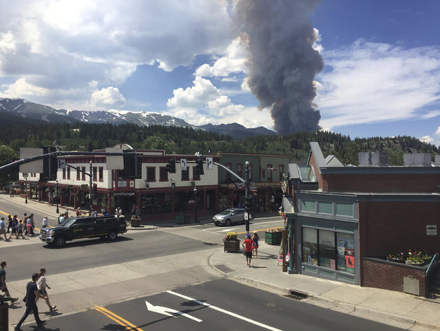 This Wednesday, July 5, 2017, photo provided by Tony Cooper shows a wildfire burning near Breckenridge, Colo. Firefighters were working Thursday to keep a wildfire that's forced the evacuation of hundreds of people from spreading toward homes near Colorado's Breckenridge Ski Resort and the nearby historic town. (Photo by Tony Cooper via AP Photo)