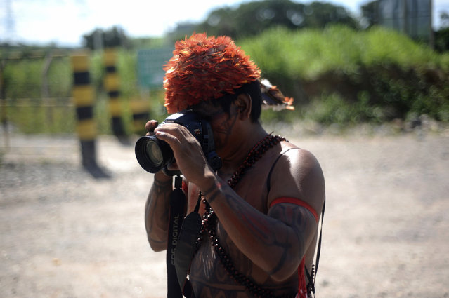 A Munduruku Indian named Paygomuyatpu takes photos with a camera left for him to use by a journalist who was expelled from the Belo Monte hydroelectric dam construction site, in Vitoria do Xingu, near Altamira in Para State, Brazil, May 5, 2013. (Photo by Lunae Parracho/Reuters)