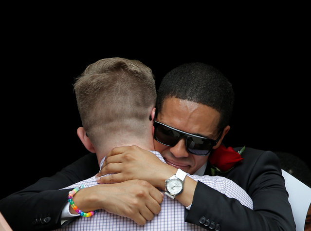 Mourners hug after a funeral service for Christopher Leinonen, who was killed at the Pulse gay nightclub, at Cathedral Church of St. Luke in Orlando, Florida, U.S. June 18, 2016. (Photo by Jim Young/Reuters)