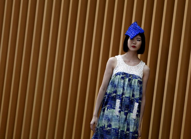 A model presents a creation of fashion brand Romei during Tokyo Fantashion at a shopping district in Tokyo, Japan, August 16, 2015. Tokyo Fantashion is a one-day showcase event of up-and-coming fashion trends, organised by Tokyo Creators, a group of 20 new brands. (Photo by Yuya Shino/Reuters)