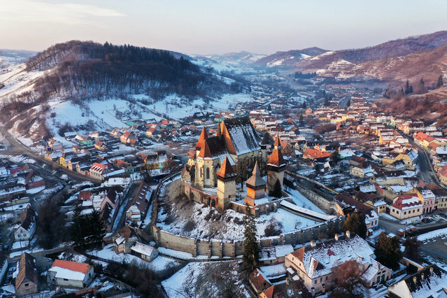 The village of Biertan and its fortified church are seen under a dusting of snow in Romania on February 20, 2019. (Photo by Amos Chapple/Radio Free Europe/Radio Liberty)