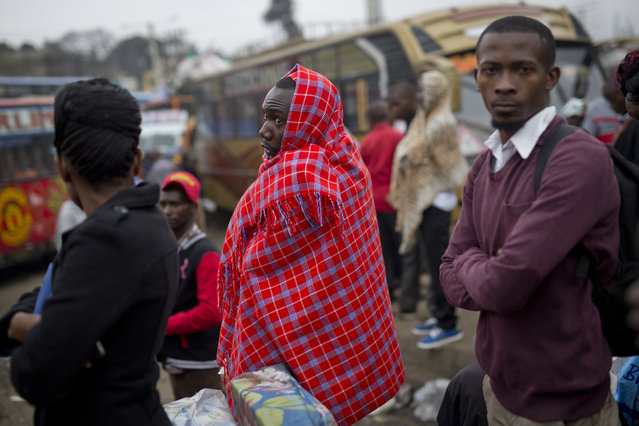 Kenyans wait for their bus in Nairobi, Kenya, Monday August 7, 2017. (Photo by Jerome Delay/AP Photo)