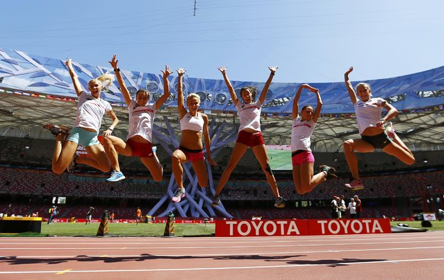 Athletes from Poland pose for a group photo in the Bird's Nest Stadium at the Wold Athletics Championships in Beijing, China, August 21, 2015. (Photo by Pawel Kopczynski/Reuters)
