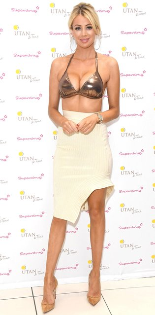 """Olivia Attwood celebrates the nationwide launch of """"UTan & Tone"""" into Superdrug stores at Superdrug, Westfield White City on August 22, 2017 in London, England. (Photo by Stuart C. Wilson/Getty Images)"""