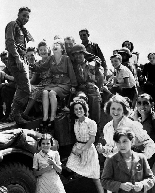 Happy French children of Liberated Paris greeting Allied soldiers  August 25, 1944. (Photo by AP Photo)
