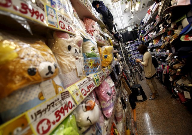 A shopper looks at items inside a discount store at a shopping district in Tokyo, Japan, July 29, 2015. (Photo by Yuya Shino/Reuters)