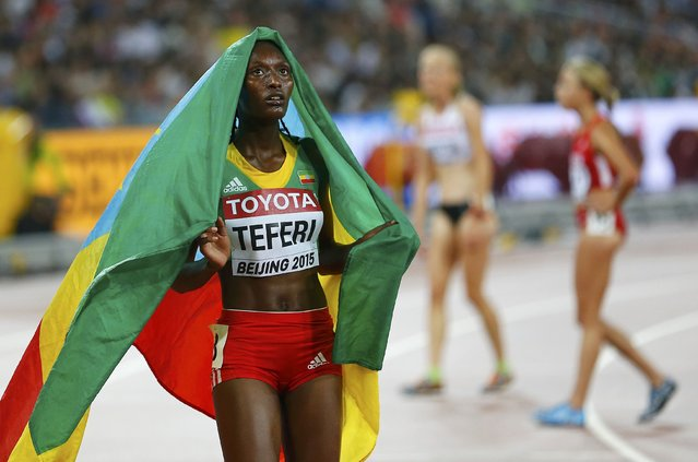 Ethiopia's Senbere Teferi celebrates finishing second in the women's 5,000 metres final during the 15th IAAF World Championships at the National Stadium in Beijing, China August 30, 2015. (Photo by Damir Sagolj/Reuters)